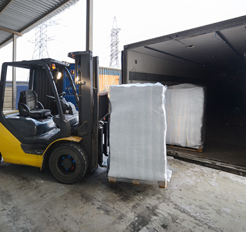 Conex Shipping Container being loaded up by forklift